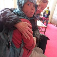 "Kathy Kelly with Safar, an Afghan ""street child"""