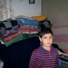 Syrian boy in rented flat in Mafraq, Jordan. MCC Photo/Nada Zabeneh