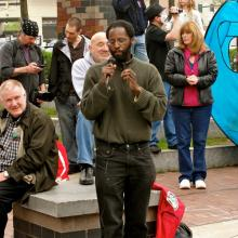 Aly Wane speaking at an event in Syracuse - photo courtesy of Define American.