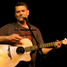 Jason Harrod in concert, Raleigh NC 2010. Image via the artist.