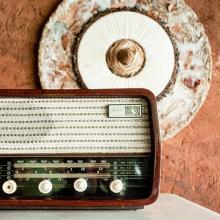 Old radio, adobe wall. Image via Wylio http://bit.ly/zFgPqk