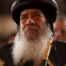 Pope Shenouda III, the Coptic Christian pontiff, listens to President Obama deli