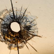 Gun shot in window, Iurii Konoval / Shutterstock.com