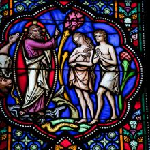Stained glass window depicting Adam & Eve, jorisvo / Shutterstock.com