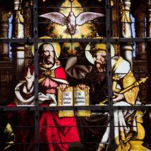 Stained glass window depicting the Holy Trinity, jorisvo / Shutterstock.com