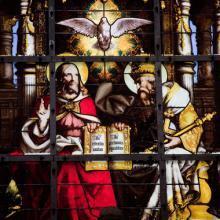 Stained glass window depicting the Holy Trinity, jorisvo / Shutterstock.com