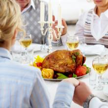 Photo: Family holiday meal, © Pressmaster / Shutterstock.com
