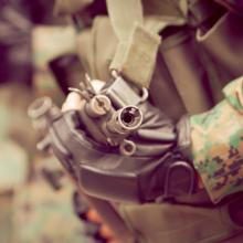 Soldier with assault weapon, Sunshine Pics/ shutterstock.com