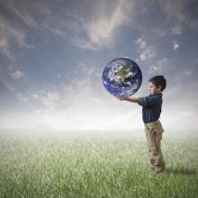 Young boy trying to save the world, alphaspirit / Shutterstock.com