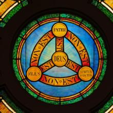 Stained glass illustration of the Holy Trinity, Nancy Bauer / Shutterstock.com
