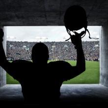 Football player in a tunnel, Brocreative / Shutterstock.com