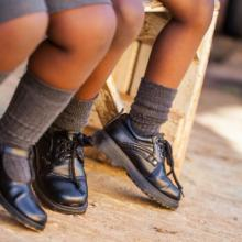 Two schoolchildren wait for the bus, Nolte Lourens / Shutterstock.com
