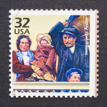 Stamp of an immigrant family. Photo courtesy catwalker/shutterstock.com
