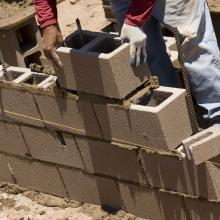 Cinder brick laying, Lou Oates / Shutterstock.com