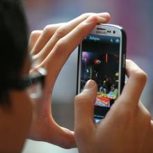 Man using Instagram to share photo, 1000 Words / Shutterstock.com