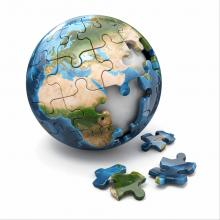 Puzzle of the globe with pieces missing. Image courtesy Maxx-Studio/shutterstock