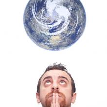 Man praying for the earth, Gandolfo Cannatella / Shutterstock.com