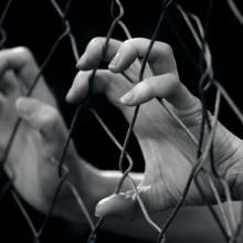 Sex trafficking illustration, ChameleonsEye / Shutterstock.com