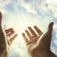 Hands in prayer. Image via STILLFX/shutterstock.com