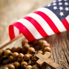Cross and flag. Image via Jiri Hera/shutterstock.com