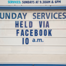 A church sign stating that online Sunday services are being held via Facebook.