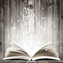 An open book with letters in flight. Image courtesy robert_s/shutterstock.com.