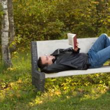 Man reading in the park, dragon_fang / Shutterstock.com