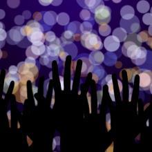 Hands streteched toward lights, pukach / Shutterstock.com
