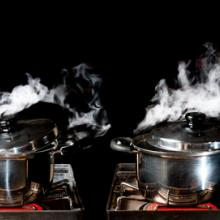 Two pots reach the boiling point. Image courtesy Showcake/shutterstock.com