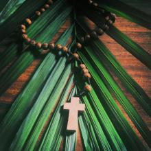The cross and the palm frond. Image via Muskoka Stock Photos/shutterstock.com