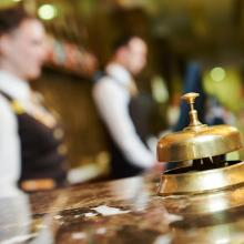 An inn's reception counter with bell. Image courtesy Dmitry Kalinovsky/shutterst