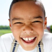 Smiling child,  mimagephotography / Shutterstock.com
