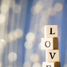 Blocks spelling 'love.' Gita Kulinitch Studio / Shutterstock.com