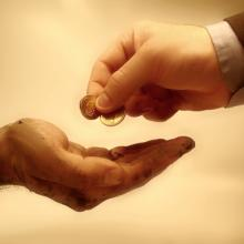 Giving money photo, Konstantinos Kokkinis / Shutterstock.com