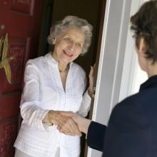 Door-to-door solicitor photo, EdBockStock / Shutterstock.com