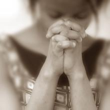 Praying woman, EML / Shutterstock.com