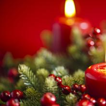 An advent candle burns in the wreath. Image courtesy 3523studio/shutterstock.com