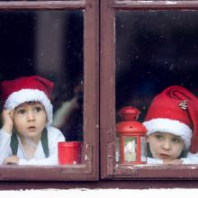 Two boys wait for Santa. Image courtesy Tomsickova Tatyana/shutterstock.com