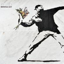Banksy graffiti piece: 1000 Words / Shutterstock.com