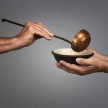 Giving food photo, James Steidl/Shutterstock.com