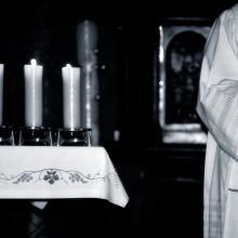 Priest during Mass, Gordan / Shutterstock.com