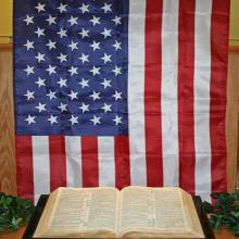 American flag and the Bible, SUE ASHE / Shutterstock.com