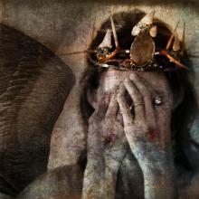 Jesus-like image hiding face, Elena Ray / Shutterstock.com