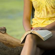 Woman reading Bible, Jacob Gregory / Shutterstock.com