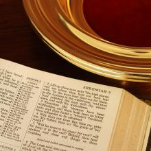 Collection plate and bible, Wellford Tiller, Shutterstock.com
