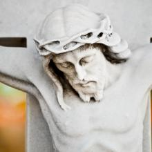 Jesus bows his head on the cross. Image courtesy Kamira/shutterstock.com