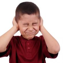 Boy covering his ears,  3445128471 / Shutterstock.com