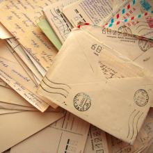 Photo of pile of letters, Kudryashka / Shutterstock.com