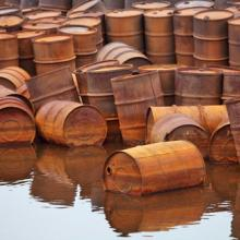 Rusty fuel and chemical drums on the Arctic coast, Vladimir Melnik / Shutterstoc