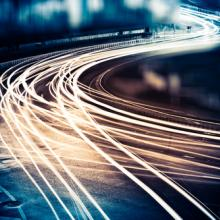Light trails from fast-moving cars, ssguy / Shutterstock.com